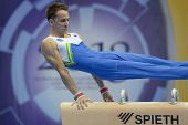 MOSCOW, RUSSIA - APRIL 20: Saso Bertoncelj, Slovenia performs exercise on pommel horse in final of 5