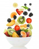 stock photo of plum fruit  - Fresh mixed fruit salad falling into a bowl of salad - JPG