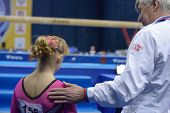 MOSCOW, RUSSIA - APRIL 21: Anastasia Grishina, Russia with her coach after exercise on balance beam