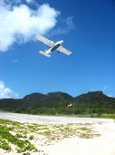 Small plane taking off from St  Barths airport