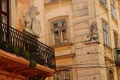 A house with a balcony and a lion in the Galician street in Lvov