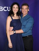 LOS ANGELES - APR 22:  Joanne Kelly & Eddie McClintock arrives to the NBC Universal Summer Press Day