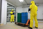 toxic substance delivering - Two specialists in protective uniforms,masks,gloves and boots, dealing