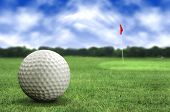 pic of golf  - golf ball in a course with striking colours - JPG