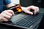 Man Holding Colorful Credit Card. Hands On Computer Keyboard