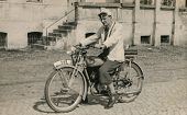 Vintage photo of man on motorbike, forties