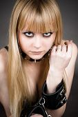 blond with leather handcuffs