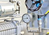 foto of valves  - new shiny industrial thermometer in boiler room - JPG
