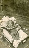 POLAND, CIRCA FIFTIES - Vintage photo of baby girl in pram, Poland, circa fifties