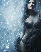 foto of cabaret  - Young and beautiful woman in sexy lingerie over the snowy winter background - JPG