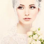 stock photo of white gown  - Portrait of beautiful bride - JPG