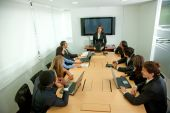 stock photo of business meetings  - Group of business people at a staff meeting - JPG
