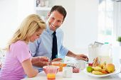 Couple Having Breakfast Before Husband Leaves For Work