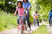 foto of bike path  - Multi Generation African American Family On Cycle Ride - JPG