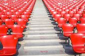 Red chairs bleachers in large stadium