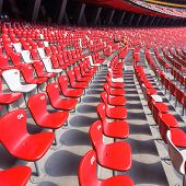 foto of bleachers  - Red chairs bleachers in large stadium - JPG