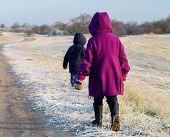 children walking in winter landscape