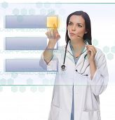 Young Doctor or Nurse Pushing Blank Button on Futuristic Translucent Panel - Ready For Your Own Copy