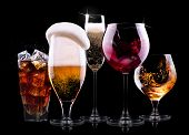 picture of mug shot  - set with different drinks on black background  - JPG