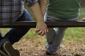 stock photo of homosexuality  - gay love on the bench - JPG