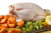 picture of pot roast  - A raw chicken and the ingredients for pot - JPG