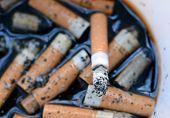 Ashtray Full Of Cigarettes Burnt Butts