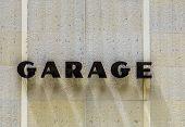Garage Sign At House Facade