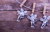 Glitter Angel Christmas toys on wooden background