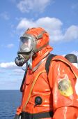 picture of decontamination  - man in chemical suit on deck of chemical tanker - JPG