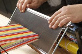 picture of handloom  - hands of craftwomen working on weaving - JPG