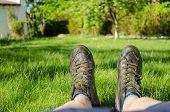 Close Up Of Women Sneakers Climbing Fine Grass
