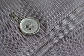 Close up pocket button on formal suit trousers