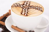 pic of scum  - Cappuccino cup with drawing on scum and coffee beans - JPG