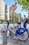 VALENCIA, SPAIN - APRIL 20, 2014: Valenbisi rental bicycle station and terminal in the streets of Va