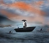 Composite image of businessman standing in a sailboat being circled by sharks
