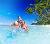 Couple with scuba gear in paradise.