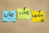 live, love, laugh - motivational words on sticky note reminders