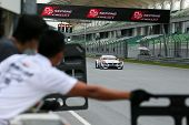 SEPANG, MALAYSIA - MAY 10, 2014: The BMW car of Jun San Chen and Ollie Millroy races down the straig