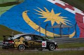 SEPANG, MALAYSIA - MAY 10, 2014: The Honda Civic car of Pitsanu Sirimonkolkasem takes to the track at the Thailand Super 2000 race of the Thailand Super Series Rd 1 in Sepang International Circuit.