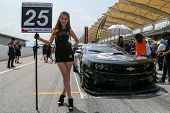 SEPANG, MALAYSIA - MAY 10, 2014: The Chevrolet Camaro car of Tomas Enge parks at the start grid at the Thailand Supercar GT3 race of the Thailand Super Series Rd 1 in Sepang International Circuit.