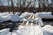Crossing Bridge Over Mountain River. Kamchatka, Russia