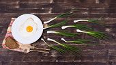 stock photo of sperm  - Egg chives plate knife and fork look like sperm competition Spermatozoons floating to ovule - JPG