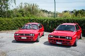 Two Red Vintage Lancia Delta Cars