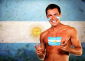 Cheering argentinian soccer fan over argentina flag background