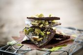 Homemade chocolate with crushed pistachios, shallow focus