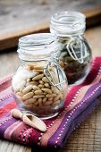 Close up of pine and pumpkin seeds in glass jar