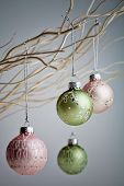 Beautiful christmas baubles hanging from white branches