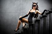 picture of catsuit  - sexy woman in cat suit lying on stairs at backyard of building - JPG