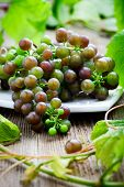 Bunch of grapes in white bowl