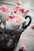 Pink chocolate pop corn in paper cones